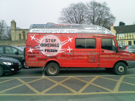 Red van by with painting of chemtrail information  painted on it
